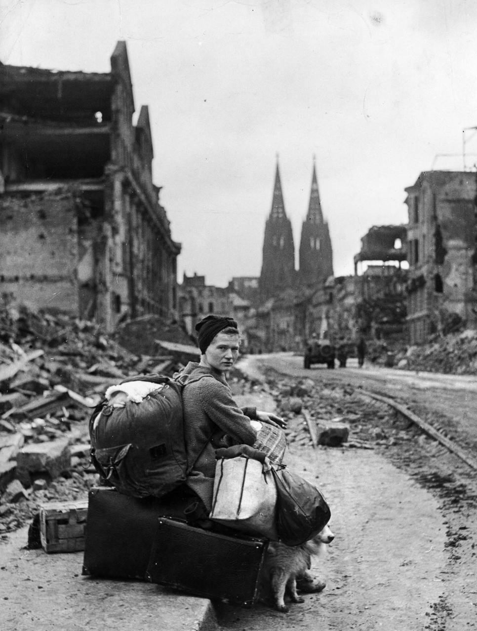 a-german-woman-sits-with-all-her-possessions-amid-the-remains-of-cologne-1945