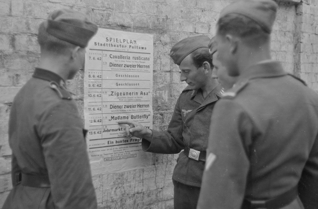 german-soldiers-reading-a-theater-schedule-12-june-1942
